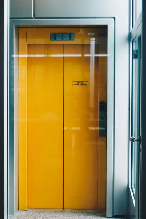 A yellow elevator for staff only