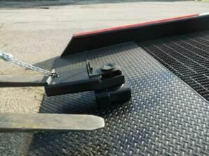 Copperloy yard ramp positioning sleeve with forklift fork slid inside.
