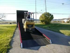 Forklift traveling up a Copperloy yard ramp rental