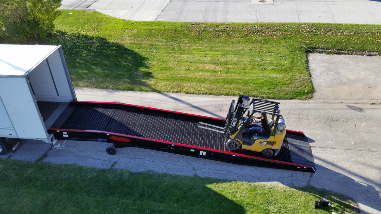 Forklift heading towards open truck trailer using a Copperloy yard ramp