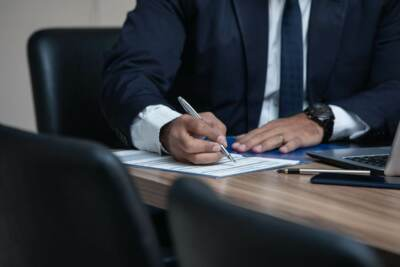 Man in navy suit writing on a piece of paper | Probate lawyers Akron Ohio