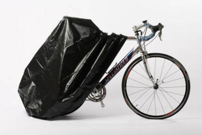 Zerust's fully enclosed bicycle cover partially open showing the front end of a bike