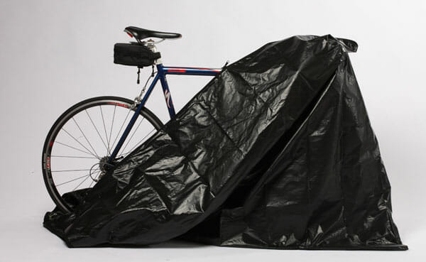 Zerust's fully enclosed bicycle cover partially open showing the back end of a bike