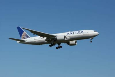 United Airlines plane in flight | Aerospace deep draw stamping