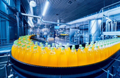 Several soda bottles on an assembly line | Food processing pump