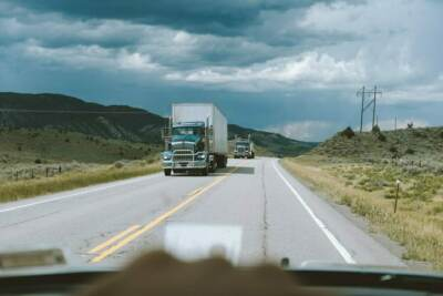 View of an oncoming semi truck on a highway | Food processing pump