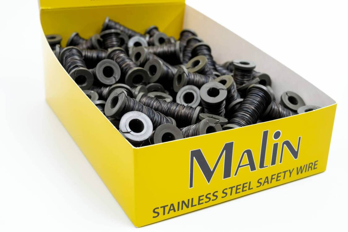 A yellow box of lock wire spools from Malin Co.