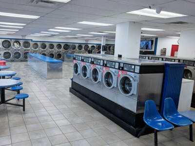 A laundromat full of coin-op washers and dryers | Commercial laundry equipment
