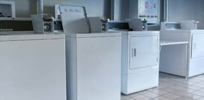 Top-loading washers in a row | Commercial laundry equipment