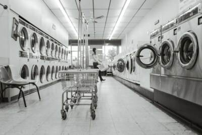 Coin-operated laundry equipment in a laundromat | Commercial laundry equipment