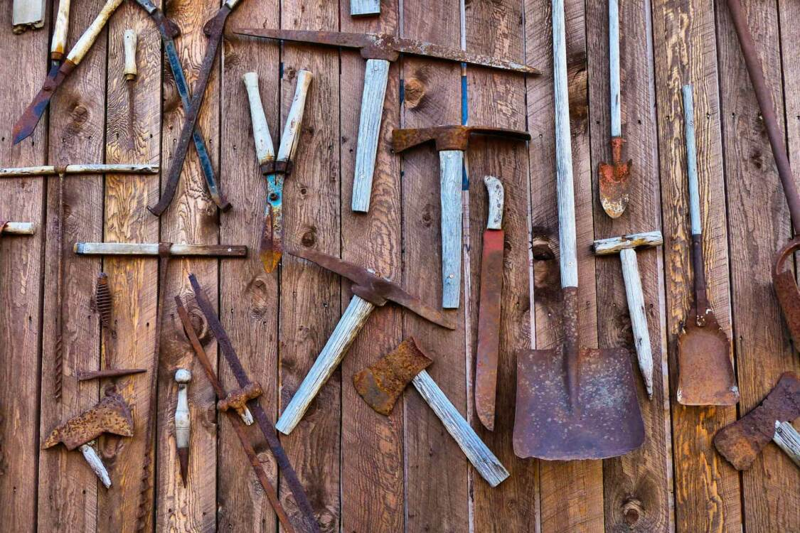 A wide variety of rusty tools in a shed | VCI Bags rust prevention