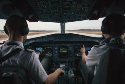 Two pilots sitting in a cockpit | Aircraft landing gear