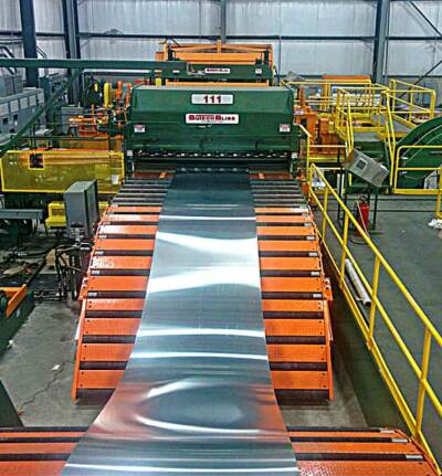 Strip metal being processed in a coil slit line machine