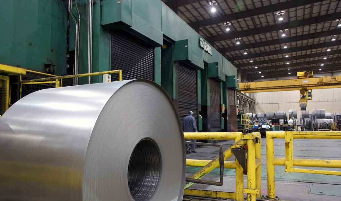 A coil of strip metal in a factory | Coil slitting line