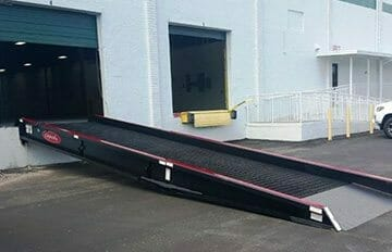 A dock ramp connected to a loading dock bay