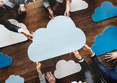 Multiple people holding cardboard clouds | IT services akron