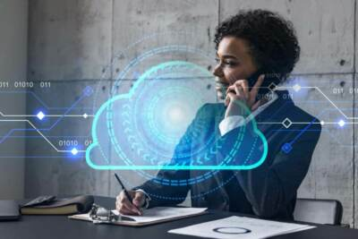 Woman talking on the phone and a transparent cloud image | IT support akron